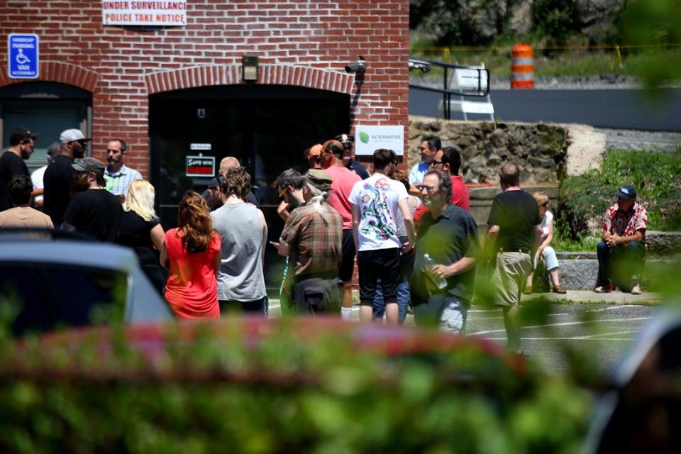 People waited for the state's first medical marijuana dispensary to open in Salem, on June 24.